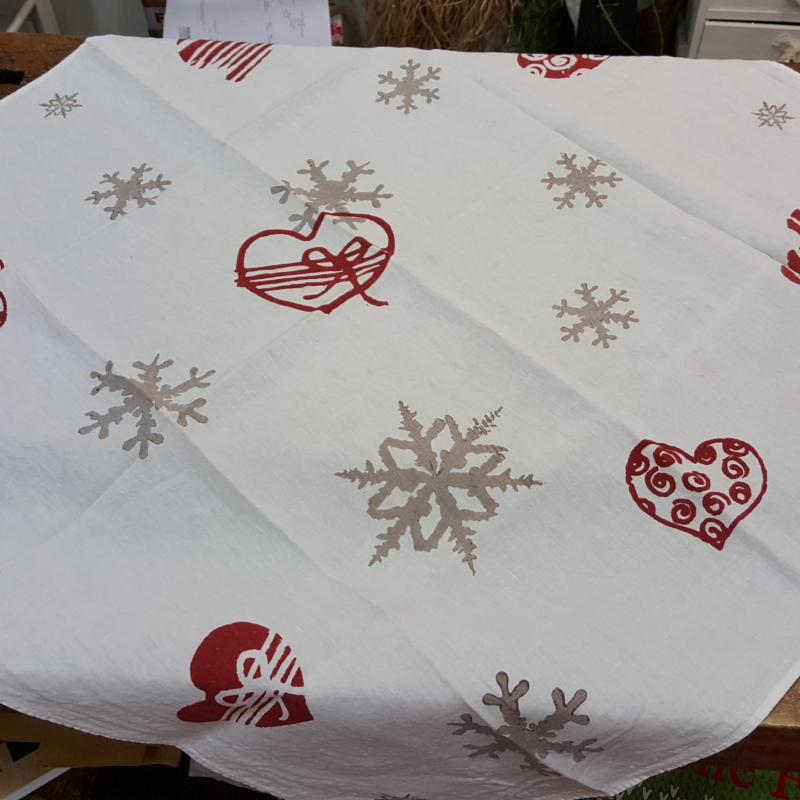 Square Christmas tablecloth. Flakes and hearts