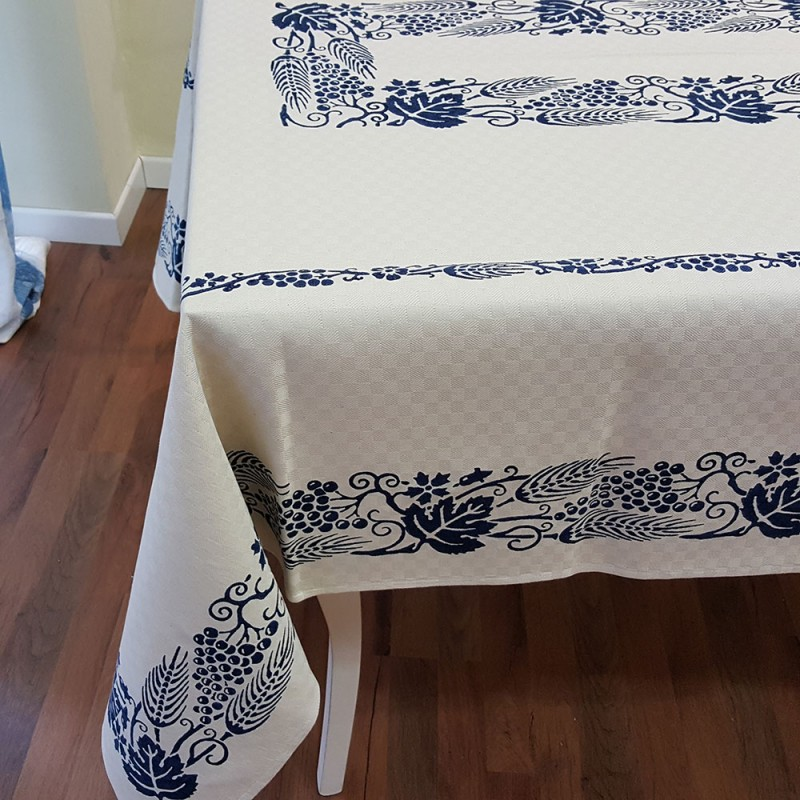 Blue tablecloth decoration of Romagna spike and grapes