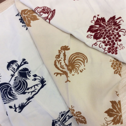 Cotton tea towel with hand-decorated
