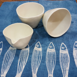 Couple of porcelain tea cups with dairy