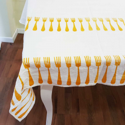 Tablecloth in natural linen print forks.
