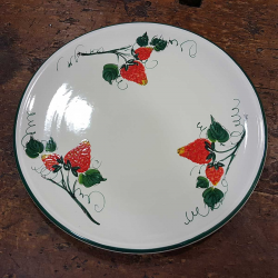 Round ceramic serving dish decorated with strawberries